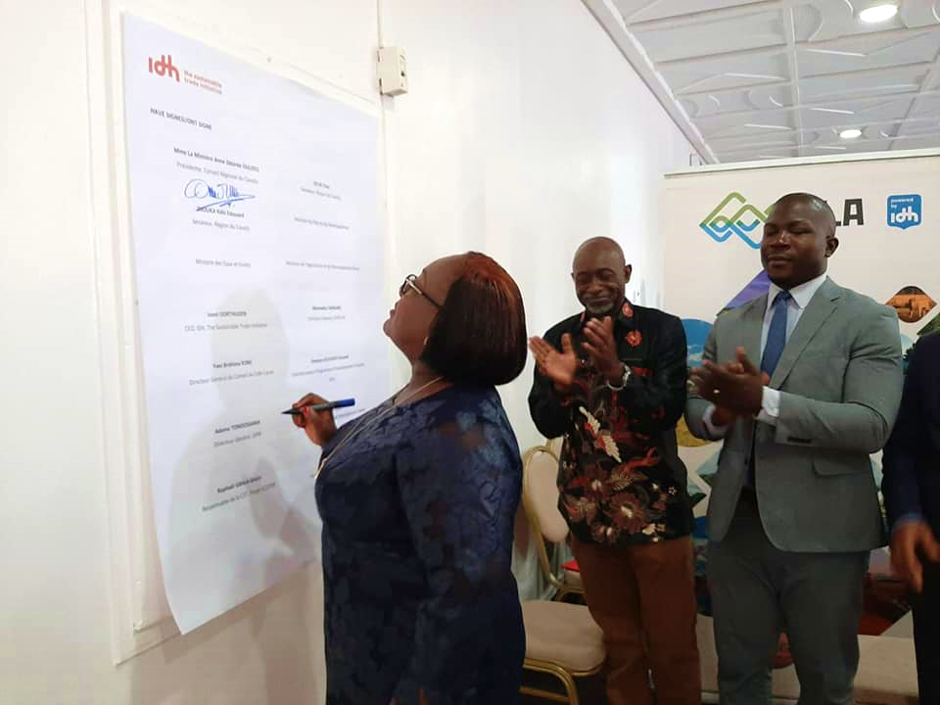 Minister Anne Ouloto signing Letter of Intent 20 Feb 2020 in Cote dIvoire